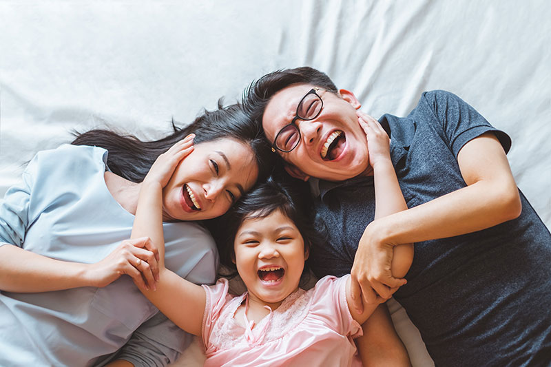 Family Happy and Smiling laying down