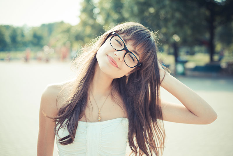 Young female outside wearing glasses